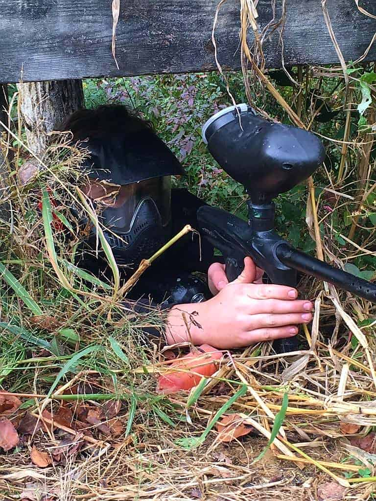 paintball player in sniper position