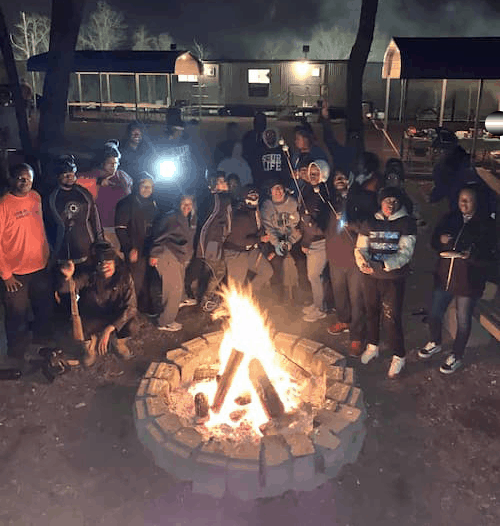 group of guys around pittsburgh campfire