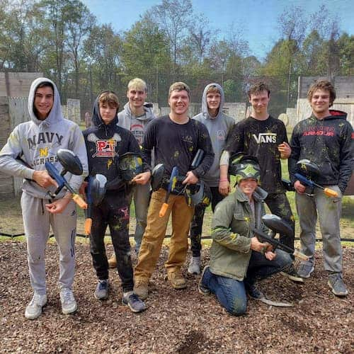 teens playing paintball at paintball field near pittsburgh